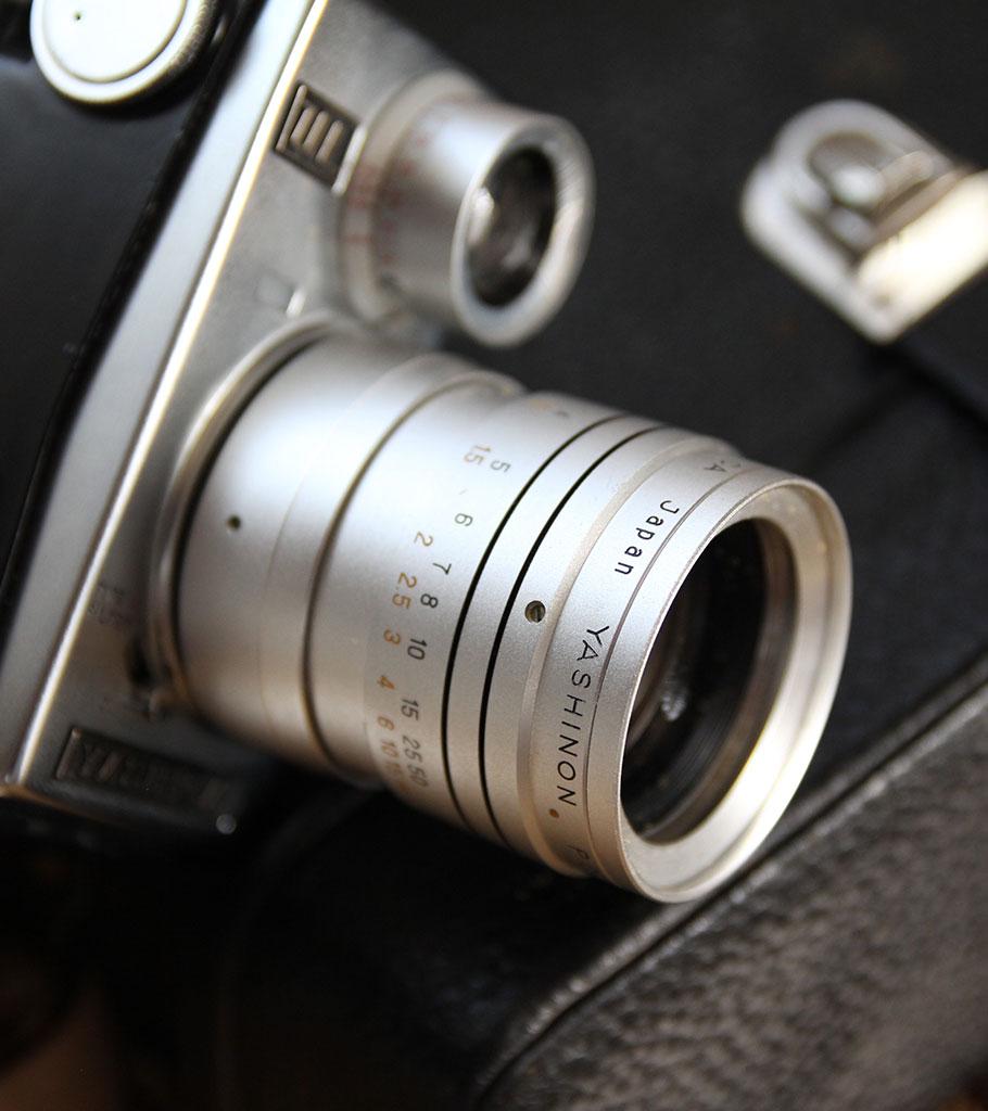 camera-910x1024